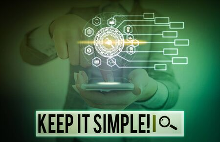 Writing note showing Keep It Simple. Business concept for ask something easy understand not go into too much detail Picture photo network scheme with modern smart device
