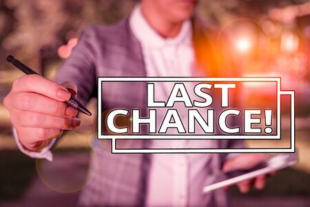 Conceptual hand writing showing Last Chance. Concept meaning final opportunity to achieve or acquire something you want Outdoor background with business woman holding lap top and pen