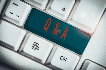 Writing note showing Q And A Question. Business concept for in which demonstrating asks questions and another one answers them White pc keyboard with note paper above the white background