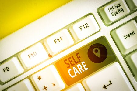 Writing note showing Self Care. Business concept for the practice of taking action to improve one s is own health White pc keyboard with note paper above the white background Stock fotó