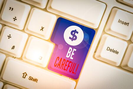 Text sign showing Be Careful. Business photo text making sure of avoiding potential danger mishap or harm White pc keyboard with empty note paper above white background key copy space Zdjęcie Seryjne