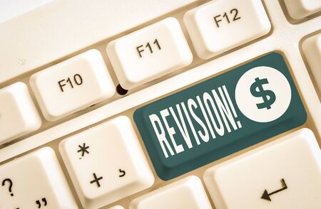 Word writing text Revision. Business photo showcasing action of revising over someone like auditing or accounting White pc keyboard with empty note paper above white background key copy space Standard-Bild