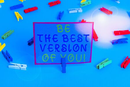 Writing note showing Be The Best Version Of You. Business concept for going to move away from where are start improving Colored clothespin papers empty reminder blue floor officepin