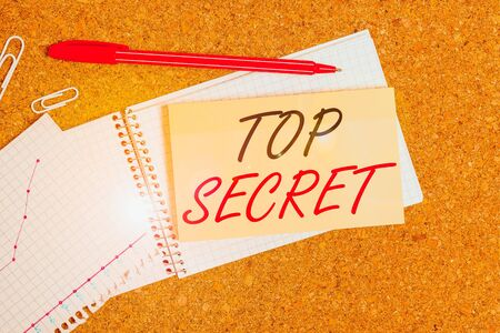 Handwriting text Top Secret. Conceptual photo protected by a high degree of secrecy Highly confidential Desk notebook paper office cardboard paperboard study supplies table chart