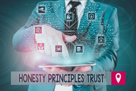 Handwriting text writing Honesty Principles Trust. Conceptual photo believing someone words for granted Telling truth Male human wear formal work suit presenting presentation using smart device Reklamní fotografie