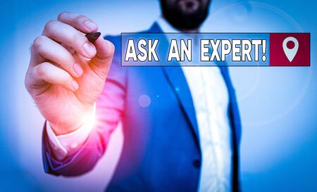 Text sign showing Ask An Expert. Business photo showcasing confirmation that have read understand and agree with guidelines Businessman pointing with pen in empty copy space