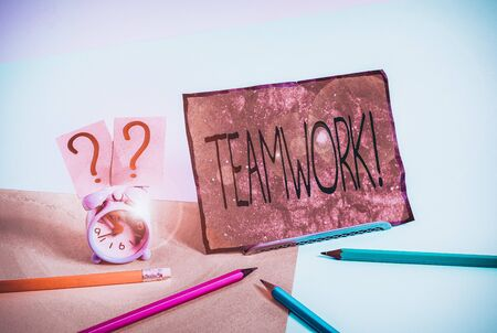Writing note showing Teamwork. Business concept for combined action of group especially when effective and efficient Mini size alarm clock beside stationary on pastel backdrop Reklamní fotografie