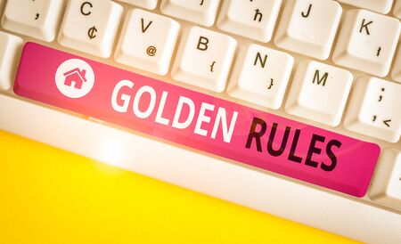 Writing note showing Golden Rules. Business concept for basic principle that should always follow to ensure success White pc keyboard with note paper above the white background Stock fotó
