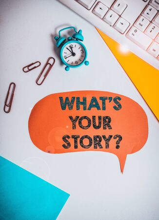 Text sign showing What S Is Your Story question. Business photo text being asked by someone about my own journey from beginning till now Flat lay above table with copy space on the bubble paper with clock and paper clips Zdjęcie Seryjne
