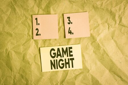 Word writing text Game Night. Business photo showcasing event in which folks get together for the purpose of getting laid Papercraft craft paper desk square spiral notebook office study supplies