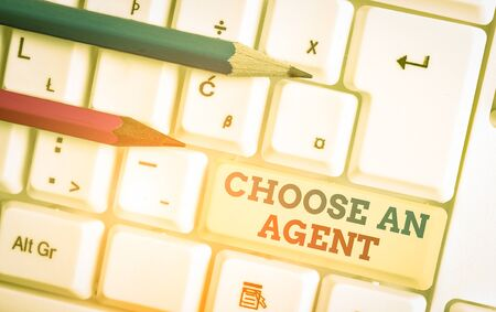 Writing note showing Choose An Agent. Business concept for Choose someone who chooses decisions on behalf of you White pc keyboard with note paper above the white background