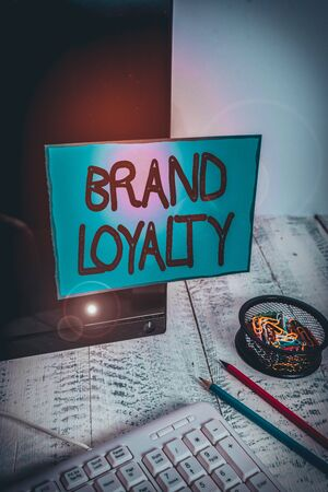 Conceptual hand writing showing Brand Loyalty. Concept meaning Repeat Purchase Ambassador Patronage Favorite Trusted Note paper taped to black screen near keyboard stationary