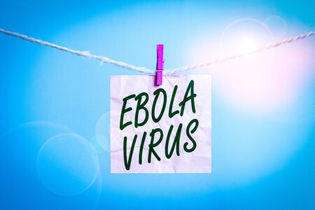 Text sign showing Ebola Virus. Business photo showcasing a viral hemorrhagic fever of huanalysiss and other primates Clothesline clothespin rectangle shaped paper reminder white wood desk