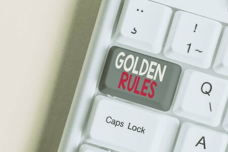 Word writing text Golden Rules. Business photo showcasing basic principle that should always follow to ensure success White pc keyboard with empty note paper above white background key copy space