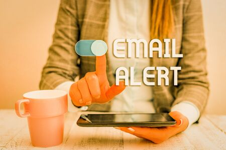 Text sign showing Email Alert. Business photo text emails auto generated nd sent to designated recipients Business woman sitting with mobile phone and cup of coffee on the table