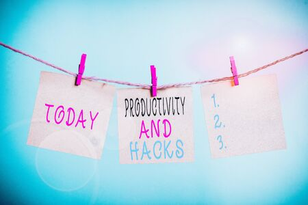 Writing note showing Productivity Hacks. Business concept for tricks that you get more done in the same amount of time Clothesline clothespin rectangle shaped paper reminder white wood desk