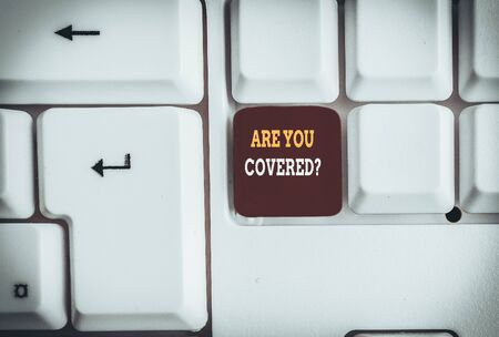 Text sign showing Are You Covered Question. Business photo text asking someone or patient if he have insurance White pc keyboard with empty note paper above white background key copy space