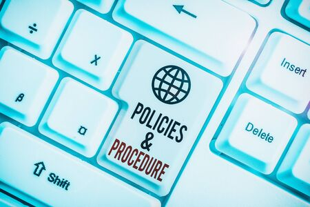Writing note showing Policies And Procedure. Business concept for list of rules defines customer and buyer rights White pc keyboard with note paper above the white background
