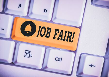 Writing note showing Job Fair. Business concept for event in which employers recruiters give information to employees White pc keyboard with note paper above the white background