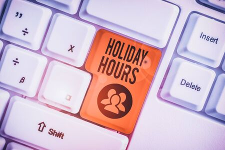 Handwriting text Holiday Hours. Conceptual photo employee receives twice their normal pay for all hours White pc keyboard with empty note paper above white background key copy space