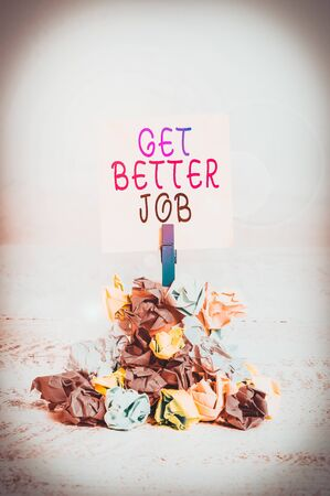 Writing note showing Get Better Job. Business concept for Looking for a high paying occupation Stress free work Reminder pile colored crumpled paper clothespin wooden space