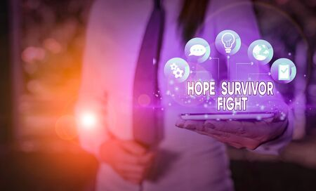Writing note showing Hope Survivor Fight. Business concept for stand against your illness be fighter stick to dreams Stockfoto