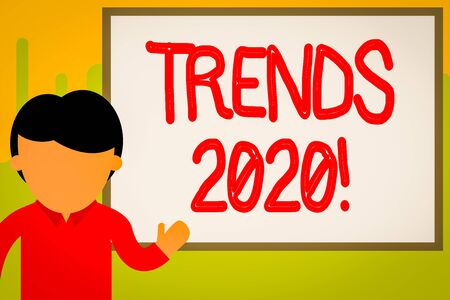 Word writing text Trends 2020. Business photo showcasing general direction in which something is developing or changing Young man standing in front whiteboard pointing to project. photo Art