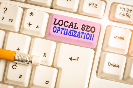 Word writing text Local Seo Optimization. Business photo showcasing increase Search Visibility to Rank on Top list White pc keyboard with empty note paper above white background key copy space
