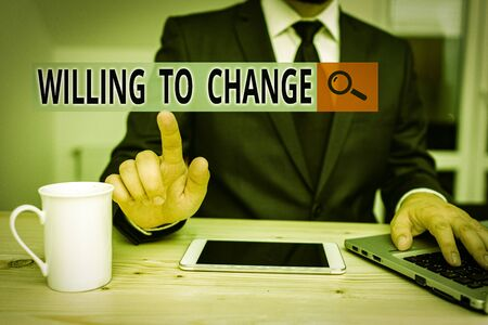 Handwriting text Willing To Change. Conceptual photo Desire to grow Eager to accept and adopt new ideas Male human wear formal clothes present presentation use hi tech smartphone