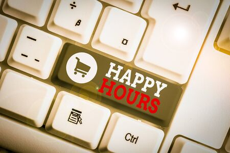 Conceptual hand writing showing Happy Hours. Concept meaning when drinks are sold at reduced prices in a bar or restaurant White pc keyboard with note paper above the white background