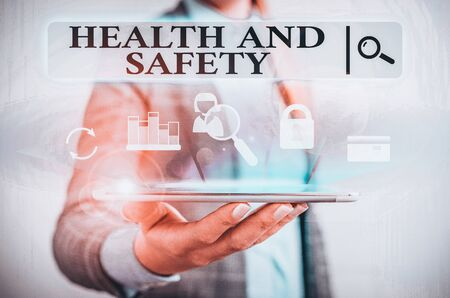 Text sign showing Health And Safety. Business photo text procedures intended to prevent accident in workplace Presenting hand blue glow text icons futuristic modern technology tech look