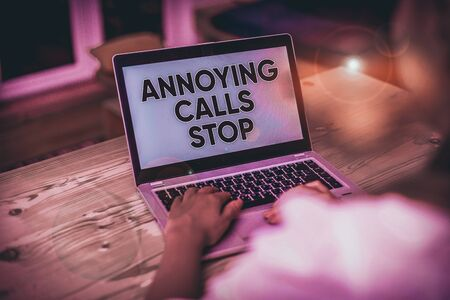 Text sign showing Annoying Calls Stop. Business photo text Prevent spam phones Blacklisting numbers Angry caller woman laptop computer smartphone mug office supplies technological devices Stock fotó