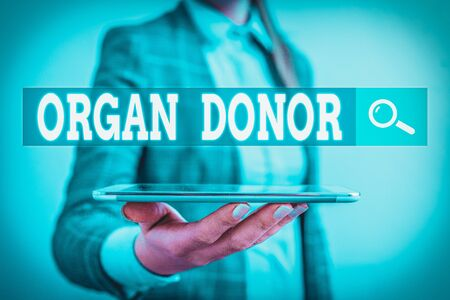 Writing note showing Organ Donor. Business concept for the act of donating an organ to a demonstrating needed a transplant Business concept with mobile phone and business woman