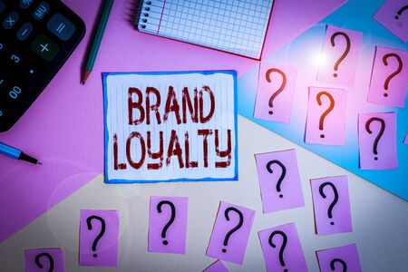 Writing note showing Brand Loyalty. Business concept for Repeat Purchase Ambassador Patronage Favorite Trusted Mathematics stuff and writing equipment above pastel colours background