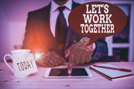 Handwriting text writing Let S Work Together. Conceptual photo Unite and Join Forces to Achieve a Common Goal Male human wear formal clothes present presentation use hi tech smartphone