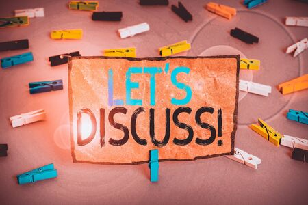 Handwriting text writing Let S Discuss. Conceptual photo asking someone to talk about something with demonstrating or showing Colored clothespin papers empty reminder pink floor background office pin
