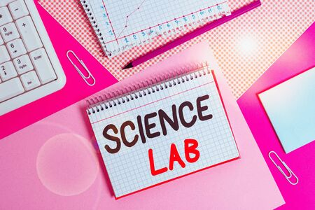 Writing note showing Science Lab. Business concept for special facility where experiments are done and with equipment Writing equipments and computer stuffs placed above colored plain table