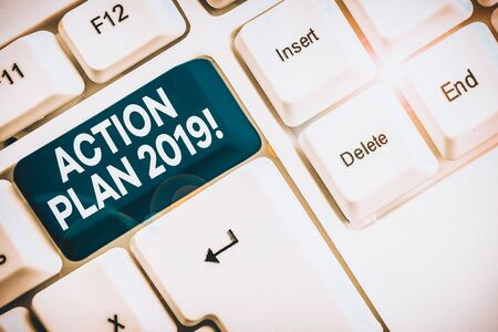 Word writing text Action Plan 2019. Business photo showcasing proposed strategy or course of actions for current year White pc keyboard with empty note paper above white background key copy space
