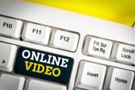 Word writing text Online Video. Business photo showcasing deals with the transmission of video over the Internet White pc keyboard with empty note paper above white background key copy space