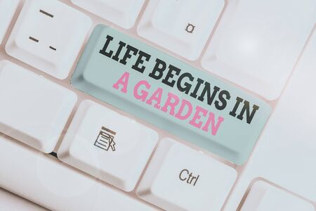 Handwriting text writing Life Begins In A Garden. Conceptual photo Agriculture Plants growing loving for gardening White pc keyboard with empty note paper above white background key copy space