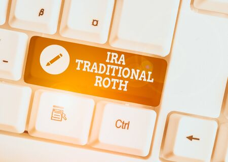 Text sign showing Ira Traditional Roth. Business photo showcasing are tax deductible on both state and federal White pc keyboard with empty note paper above white background key copy space
