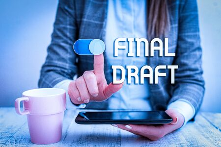 Text sign showing Final Draft. Business photo text final version of something after a lot of editing and rewriting Business woman sitting with mobile phone and cup of coffee on the table Banco de Imagens