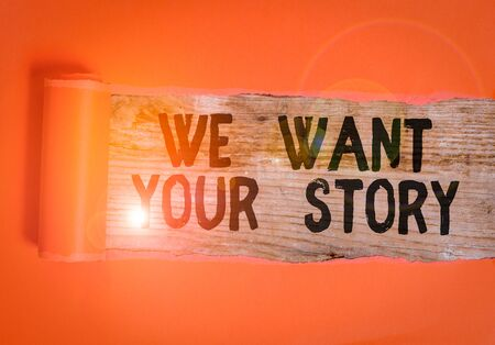 Word writing text We Want Your Story. Business photo showcasing Tell Us something a Glimpse About Your Life History Cardboard which is torn in the middle placed above a wooden classic table