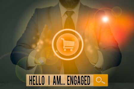 Writing note showing Hello I Am Engaged. Business concept for He gave the ring We are going to get married Wedding