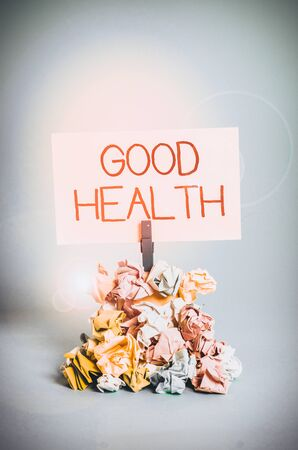 Word writing text Good Health. Business photo showcasing state of being vigorous and free from bodily or mental disease Reminder pile colored crumpled paper clothespin reminder blue background