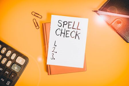 Text sign showing Spell Check. Business photo showcasing to use a computer program to find and correct spelling errors Pile of empty papers with copy space on the table