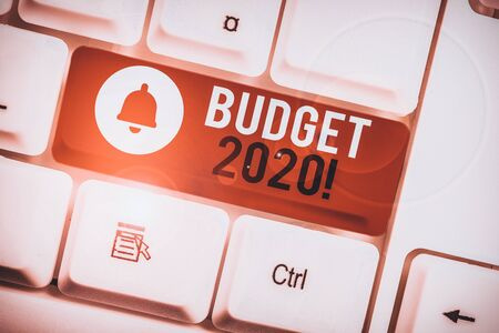 Text sign showing Budget 2020. Business photo showcasing estimate of income and expenditure for next or current year White pc keyboard with empty note paper above white background key copy space