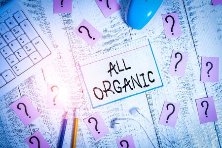 Conceptual hand writing showing All Organic. Concept meaning foods that have not been treated with synthetic pesticides Writing tools and scribbled paper on top of the wooden table
