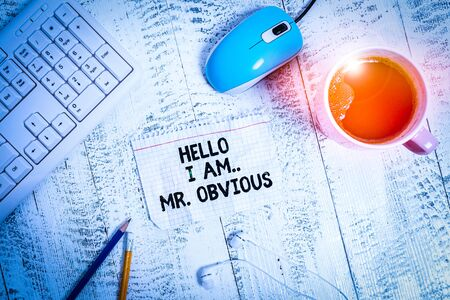 Conceptual hand writing showing Hello I Am Mrobvious. Concept meaning introducing yourself as pouplar or famous demonstrating Technological devices colored reminder paper office supplies 스톡 콘텐츠