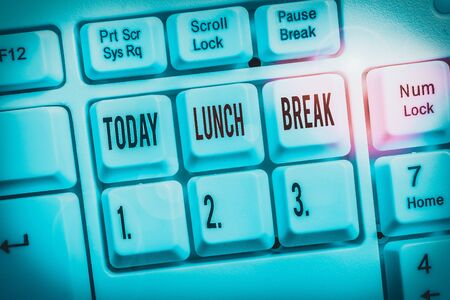 Writing note showing Lunch Break. Business concept for time when a demonstrating stops working or studying to have lunch Keyboard with note paper on white background key copy space